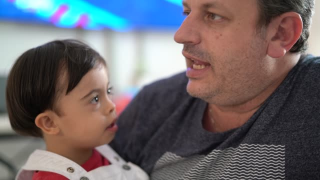 father and down syndrome son at home - father's day stock videos & royalty-free footage
