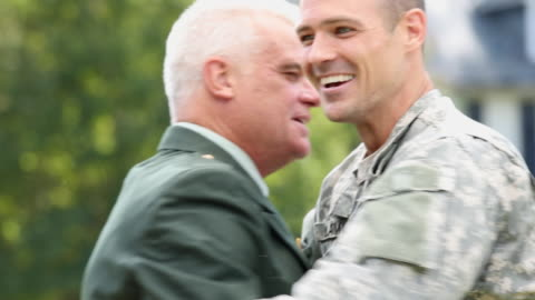 cu pan father and granfather in uniform greeting soldier son returning home from military service / richmond, virginia, united states - homecoming stock videos & royalty-free footage