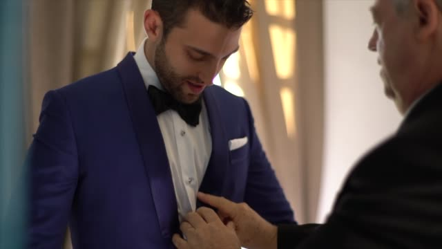 father and groom getting dressed for the wedding - christianity stock videos & royalty-free footage