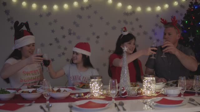 A father and his daughters having Christmas dinner together