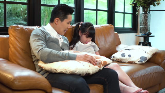 father and his daugther relaxing at home with wireless technology - genderblend stock videos & royalty-free footage