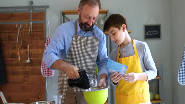 father and his son preparing cookies - food processor stock videos and b-roll footage