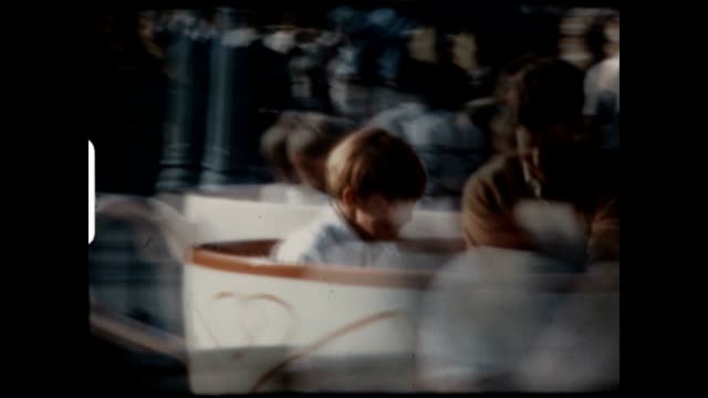 A father and his two sons enjoy a ride on the Tea Cups at Disneyland in this archival home movie from the 1960's