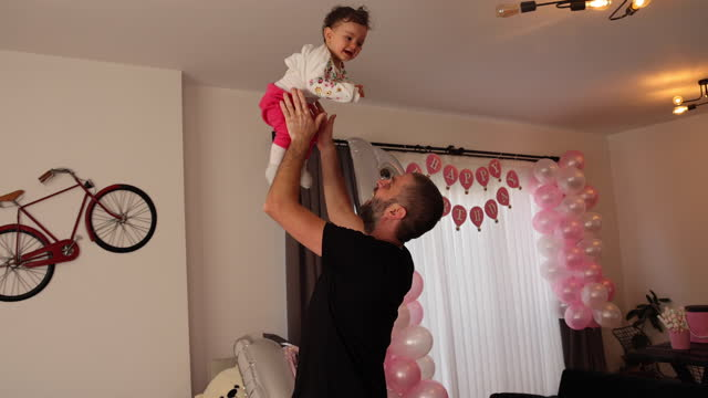 father and little daughter at home - genderblend stock videos & royalty-free footage