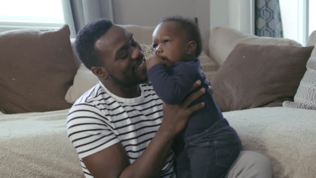 a father and newborn play together - genderblend stock videos & royalty-free footage