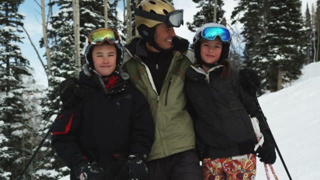 father and son and daughter skiing - part of a series stock videos & royalty-free footage