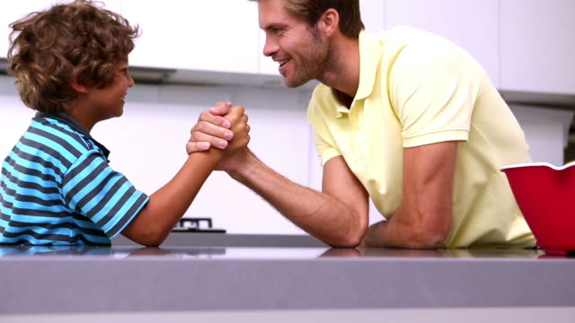 father and son arm wrestling - arm wrestling stock videos & royalty-free footage