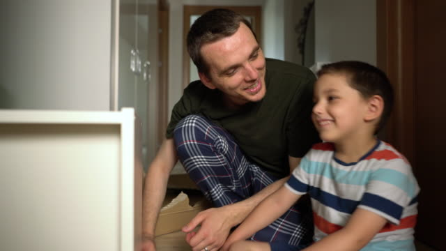 father and son assembling furniture together - 4 5 years stock videos & royalty-free footage