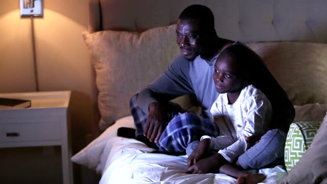 father and son at bedtime watching tv - 6 7 years stock videos & royalty-free footage