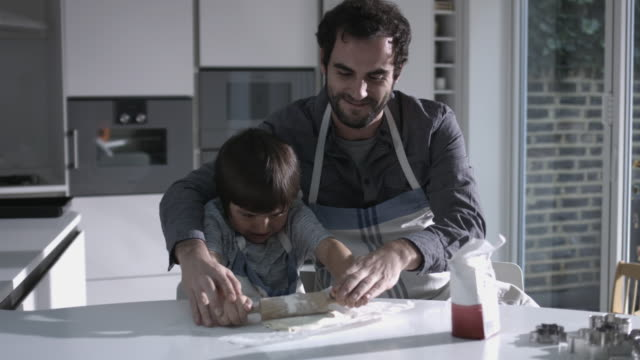father and son baking biscuits - biscuit stock videos & royalty-free footage