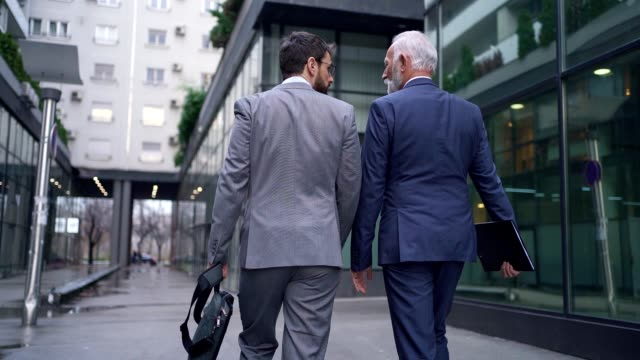 father and son businessmen walking together in suits - guru stock videos & royalty-free footage