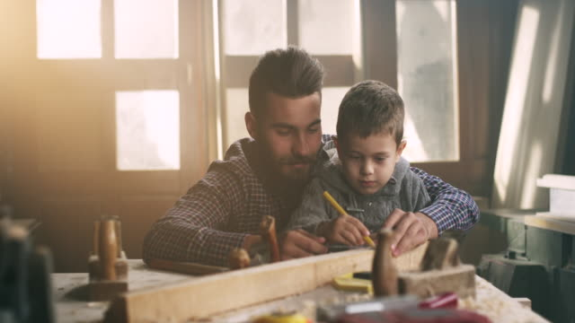 father and son carpenters - teaching stock videos & royalty-free footage