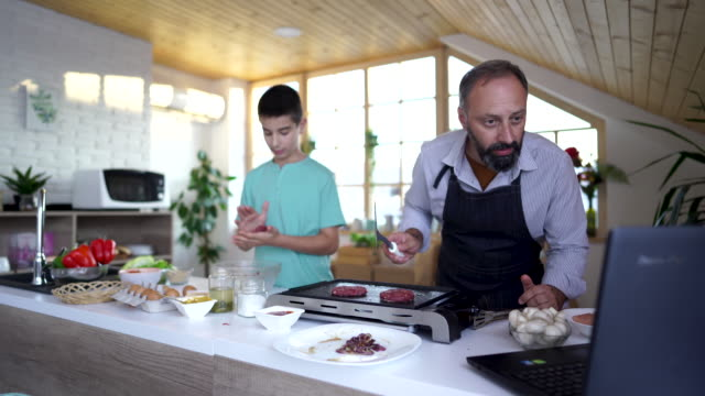 father and son cooking and vlogging - electrical equipment stock videos & royalty-free footage