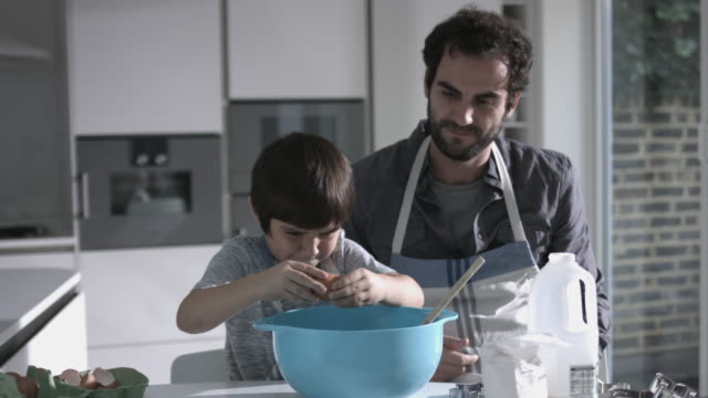 father and son cooking biscuits, smashing eggs - buttermilk biscuit stock videos & royalty-free footage