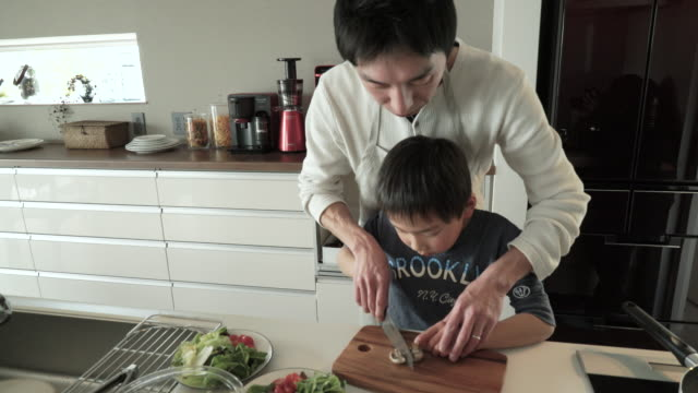 father and son cutting the mushroom - preparing food stock videos & royalty-free footage
