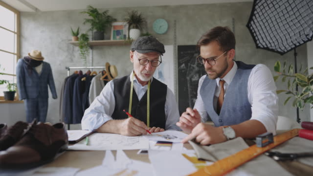father and son designing suits together - customised stock videos & royalty-free footage