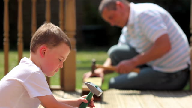 father and son diy - chores stock videos & royalty-free footage