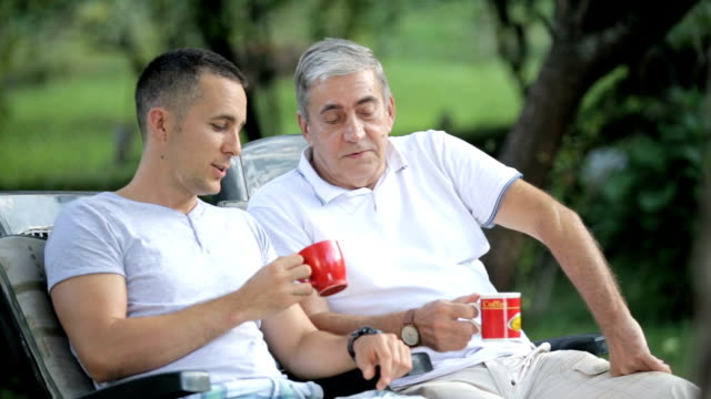 father and son drinking coffee - son stock videos & royalty-free footage
