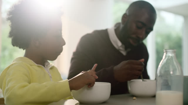 father and son eating breakfast - routine stock-videos und b-roll-filmmaterial