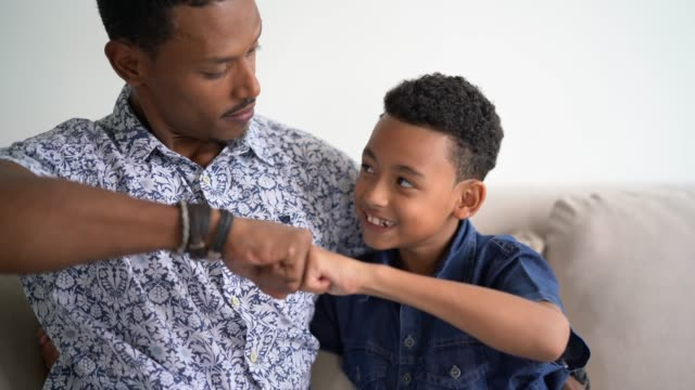 father and son embracing - colleague hug stock videos & royalty-free footage