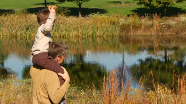 Father and Son Enjoy Nature