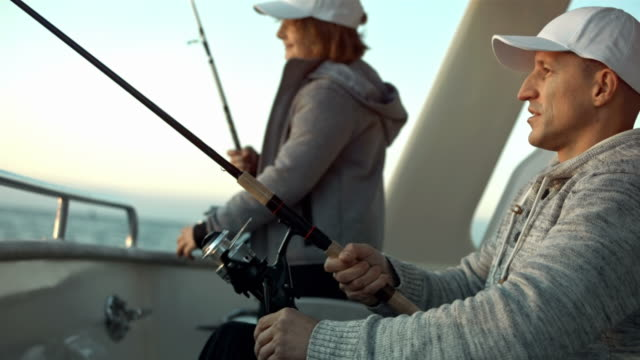 hd: father and son fishing from the stern - sailing stock videos & royalty-free footage