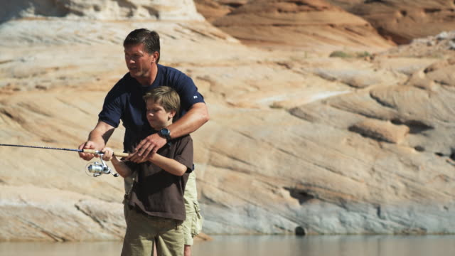 father and son fishing - cast member stock videos & royalty-free footage
