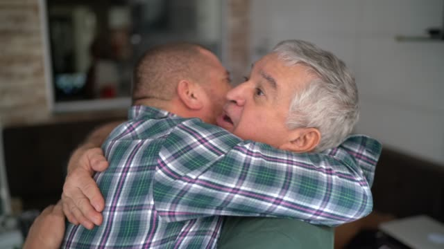 father and son / friendship embracing - gratitude stock videos & royalty-free footage