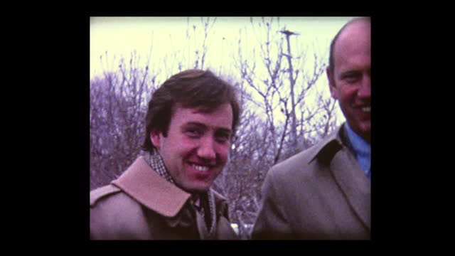 stockvideo's en b-roll-footage met 1980 father and son give friendly nudges - film moving image
