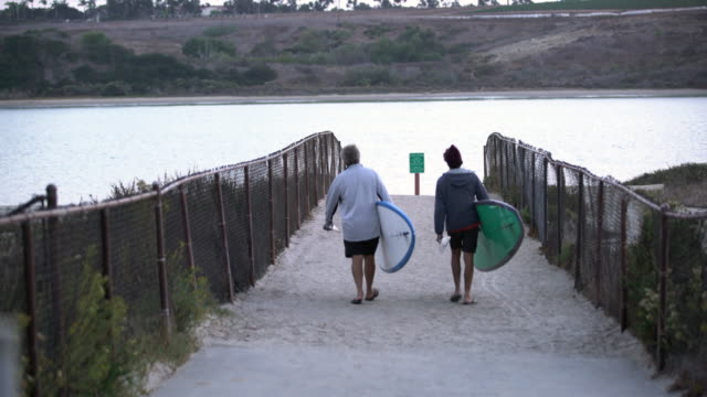 father and son going paddleboarding - using a paddle stock videos & royalty-free footage