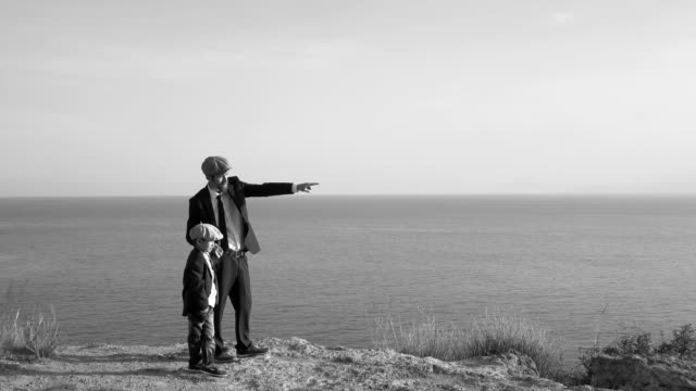 father and son having chat in outdoor - flat cap stock videos & royalty-free footage