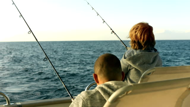HD: Father And Son Having Fun Fishing