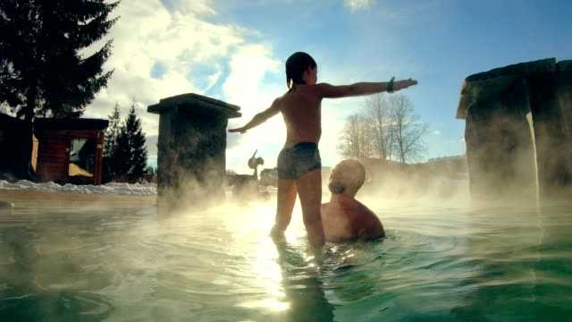 father and son having fun in geothermal pool - air vehicle stock videos & royalty-free footage