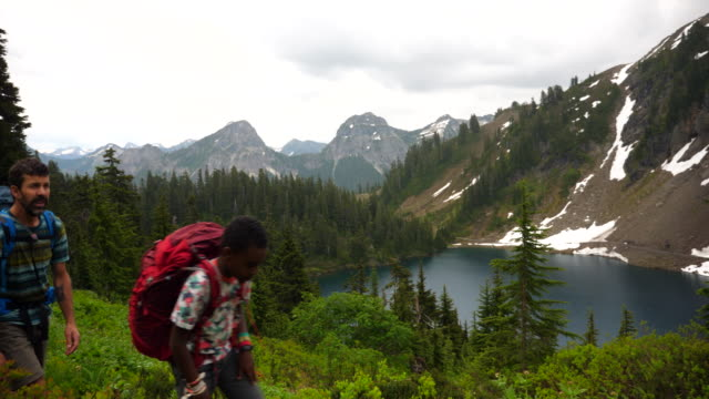 ms father and son hiking on mountain trail near alpine lake during backpacking trip - rucksack stock videos & royalty-free footage