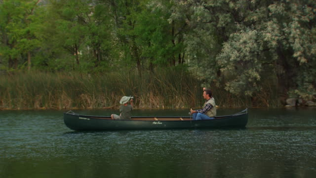 father and son in a canoe - see other clips from this shoot 1171 stock videos and b-roll footage