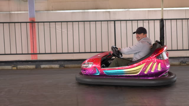 father and son in bumper car - bumper car stock videos & royalty-free footage