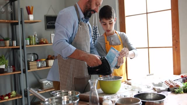 father and son in kitchen - cooking stock videos & royalty-free footage