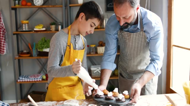 father and son in kitchen - batter food stock videos & royalty-free footage