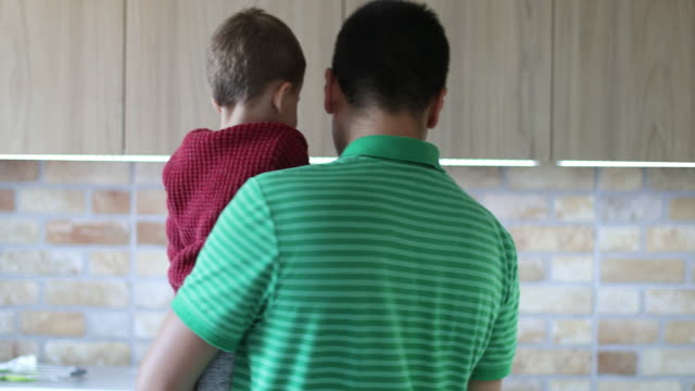 father and son in the kitchen - modern manhood stock videos & royalty-free footage