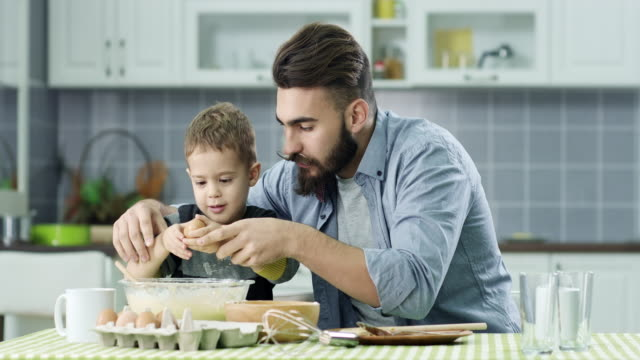 father and son in the kitchen - baking stock videos & royalty-free footage