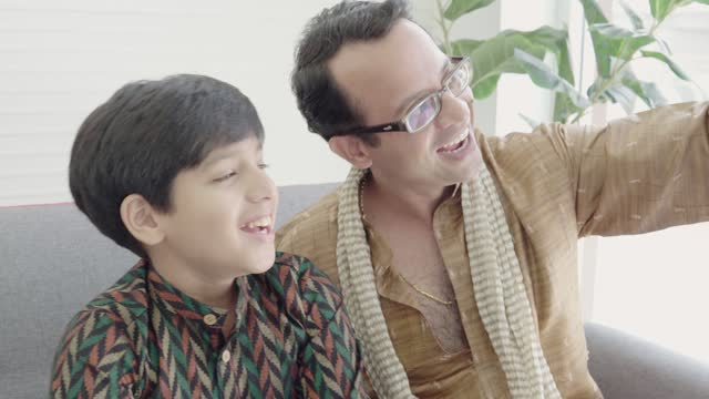 father and son india. - hugging self stock videos & royalty-free footage