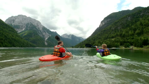 hd: father and son kayaking on the lake - leisure activity stock videos & royalty-free footage