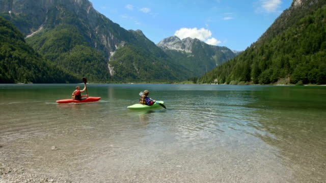 hd: father and son kayaking - canoe stock videos & royalty-free footage