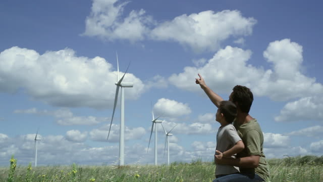 ms father and son looking around wind farm / toulouse, midi-pyrenees, france - pointing stock videos & royalty-free footage