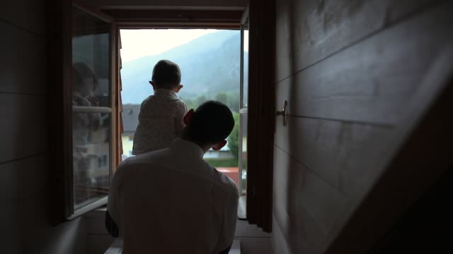 father and son looking through the window - baby boys stock videos & royalty-free footage