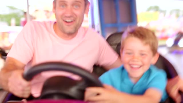father and son love the dodgem cars - fairground stock videos and b-roll footage