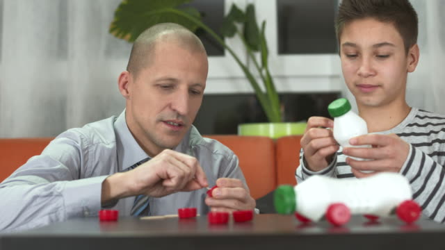 hd: father and son making recycling toy cars - one parent stock videos & royalty-free footage