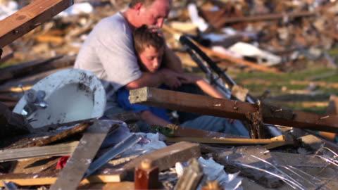 father and son - natural disaster - kaos bildbanksvideor och videomaterial från bakom kulisserna