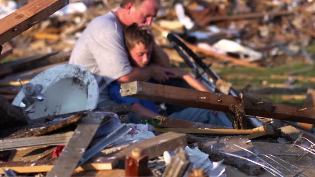 father and son - natural disaster - damaged stock videos & royalty-free footage