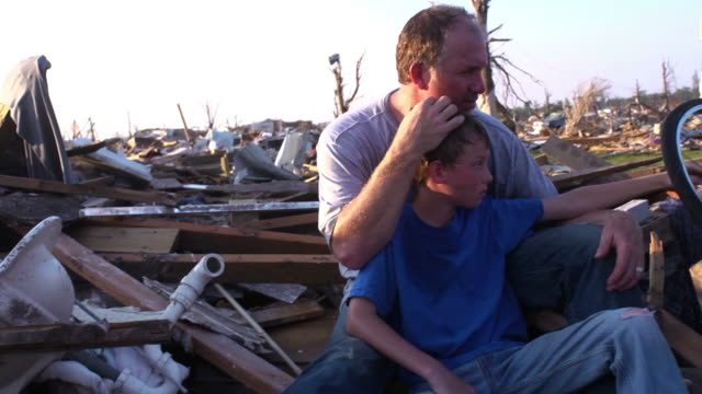 stockvideo's en b-roll-footage met father and son - natural disaster - geruïneerd